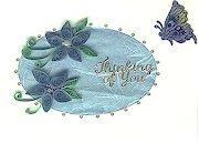 Blue quilling on light blue mulberry paper